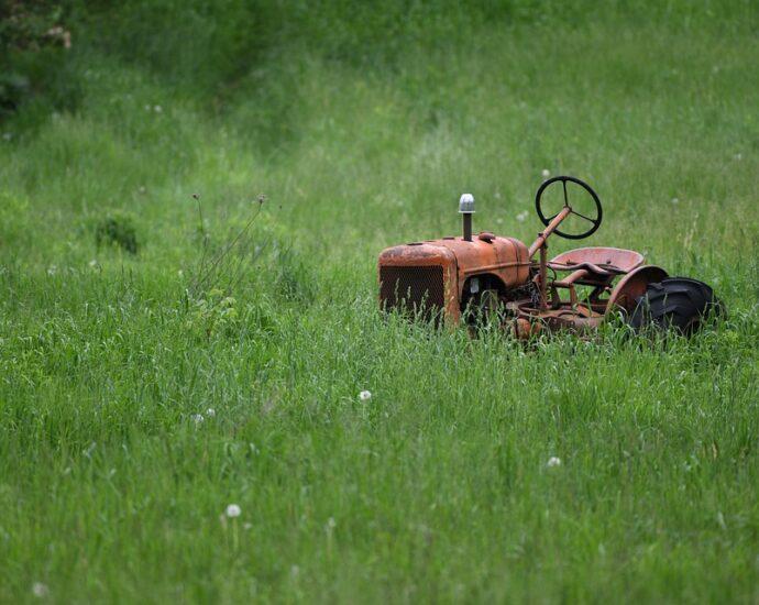 Tractor in fallow field